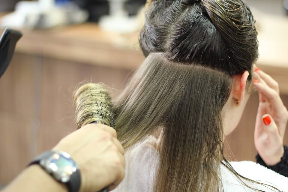 Brushing Hair keeping hair strong and healthy with essential oils