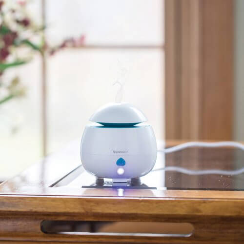 AromaPod Essential Oil Diffuser on Coffee Table