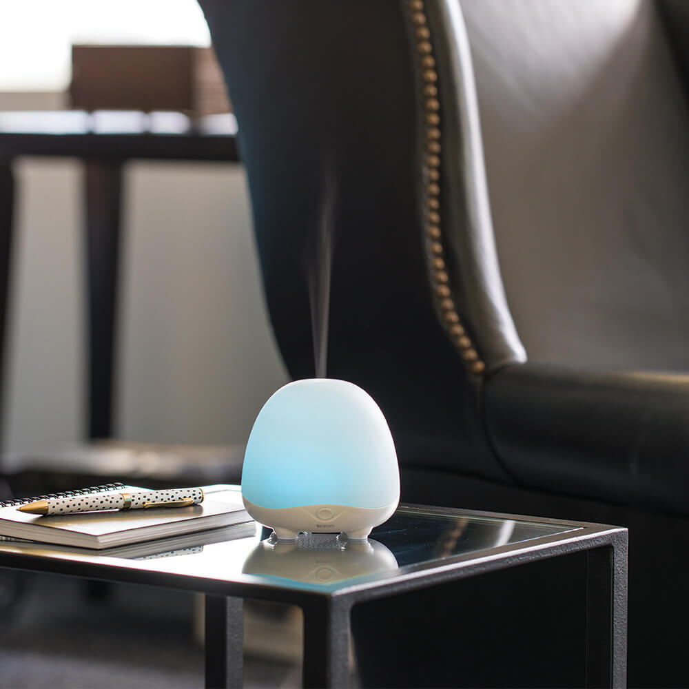 BellaMist Essential Oil Diffuser on Table next to Chair
