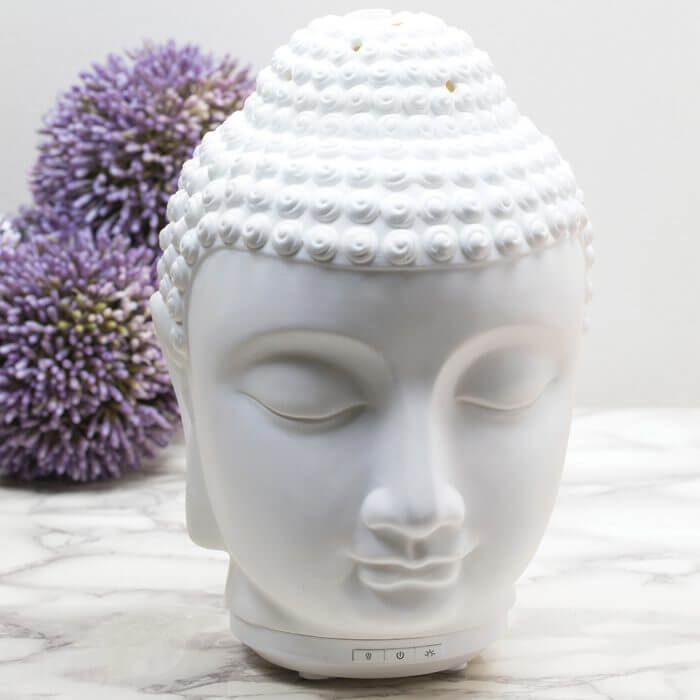 Zen Essential Oil Diffuser Next to Flowers