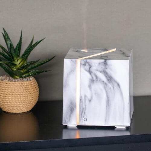 Onyx White Essential Oil Diffuser on Table