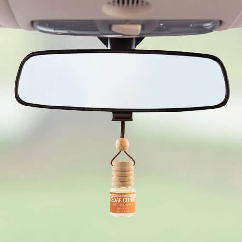 Trapeze Cedar Citrus Air Freshener on rear view mirror.jpg