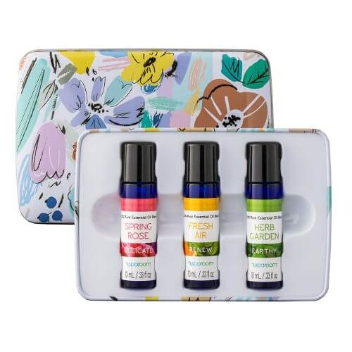 Spring Essentials Tin opened and showing off oils inside the tin