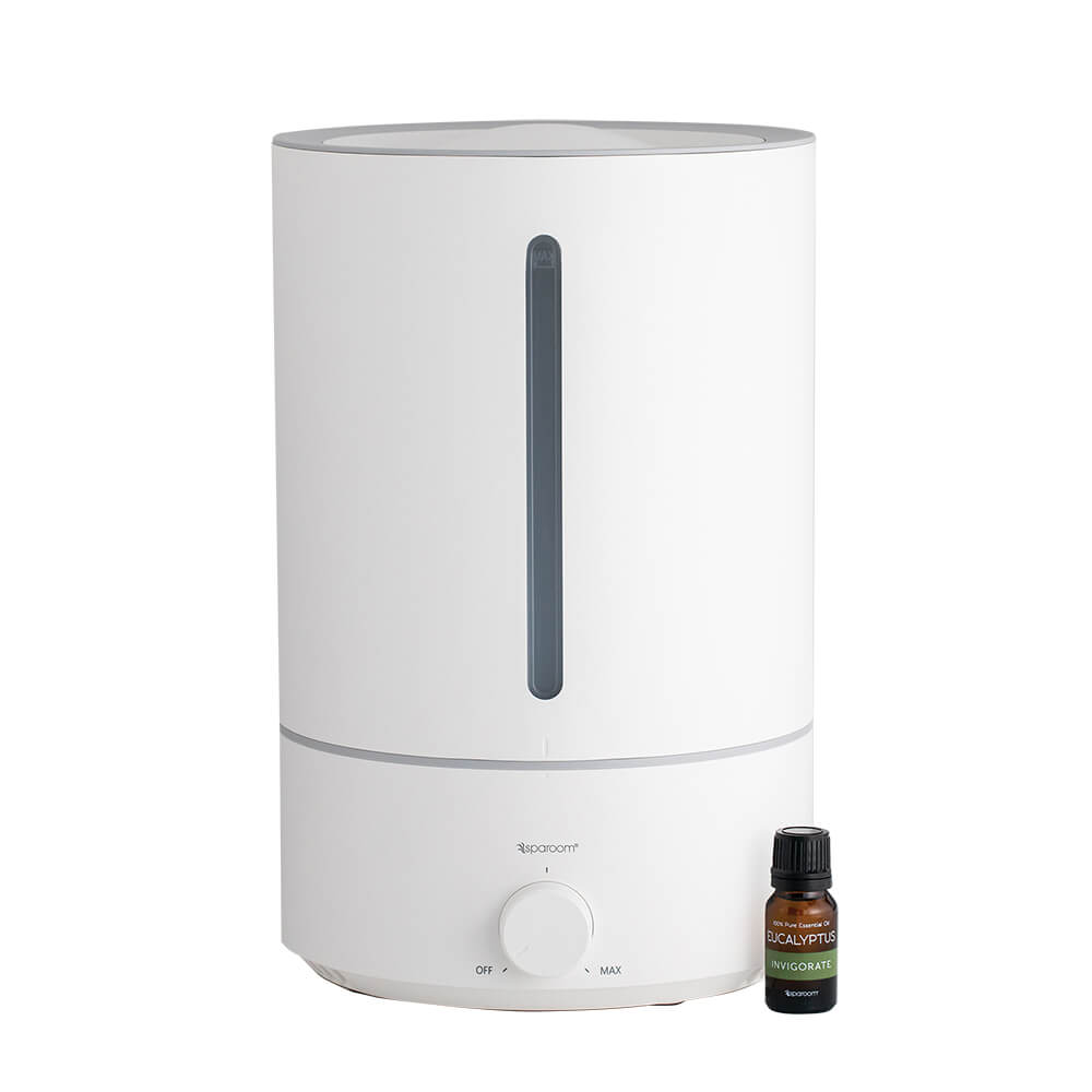 AuraMist Essential Oil Humidifier powered on with an essential oil
