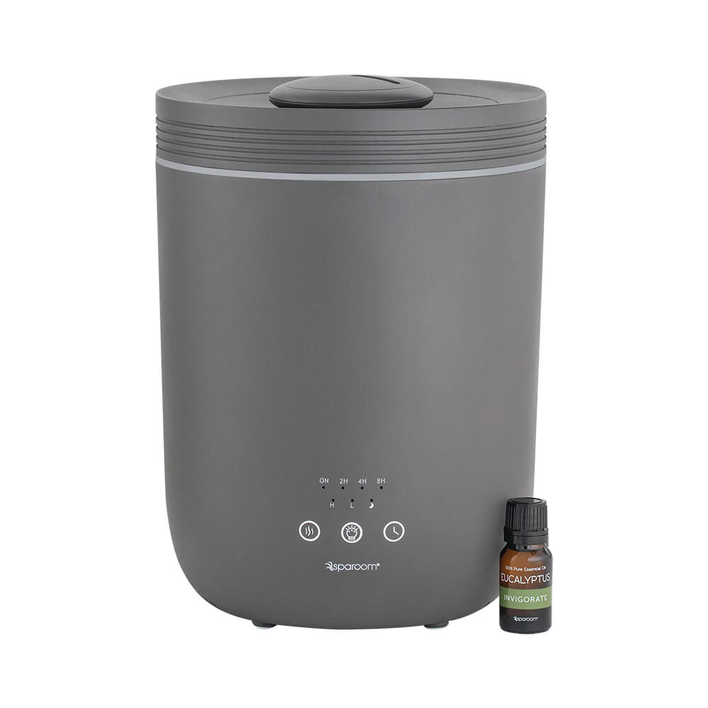 GuardianMist Gray Essential Oil Humidifier turned on with an essential oil