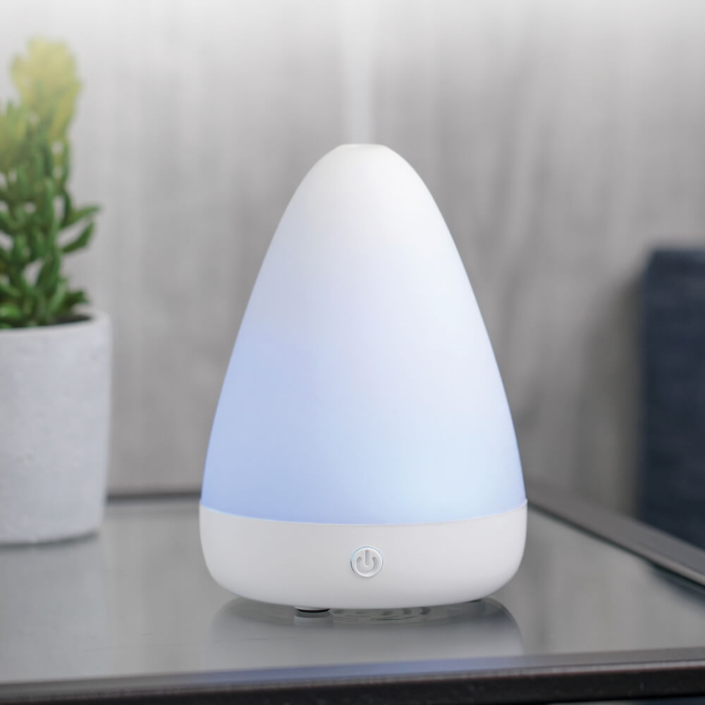 SimpleMist Ultrasonic Essential Oil Diffuser on a desk misting