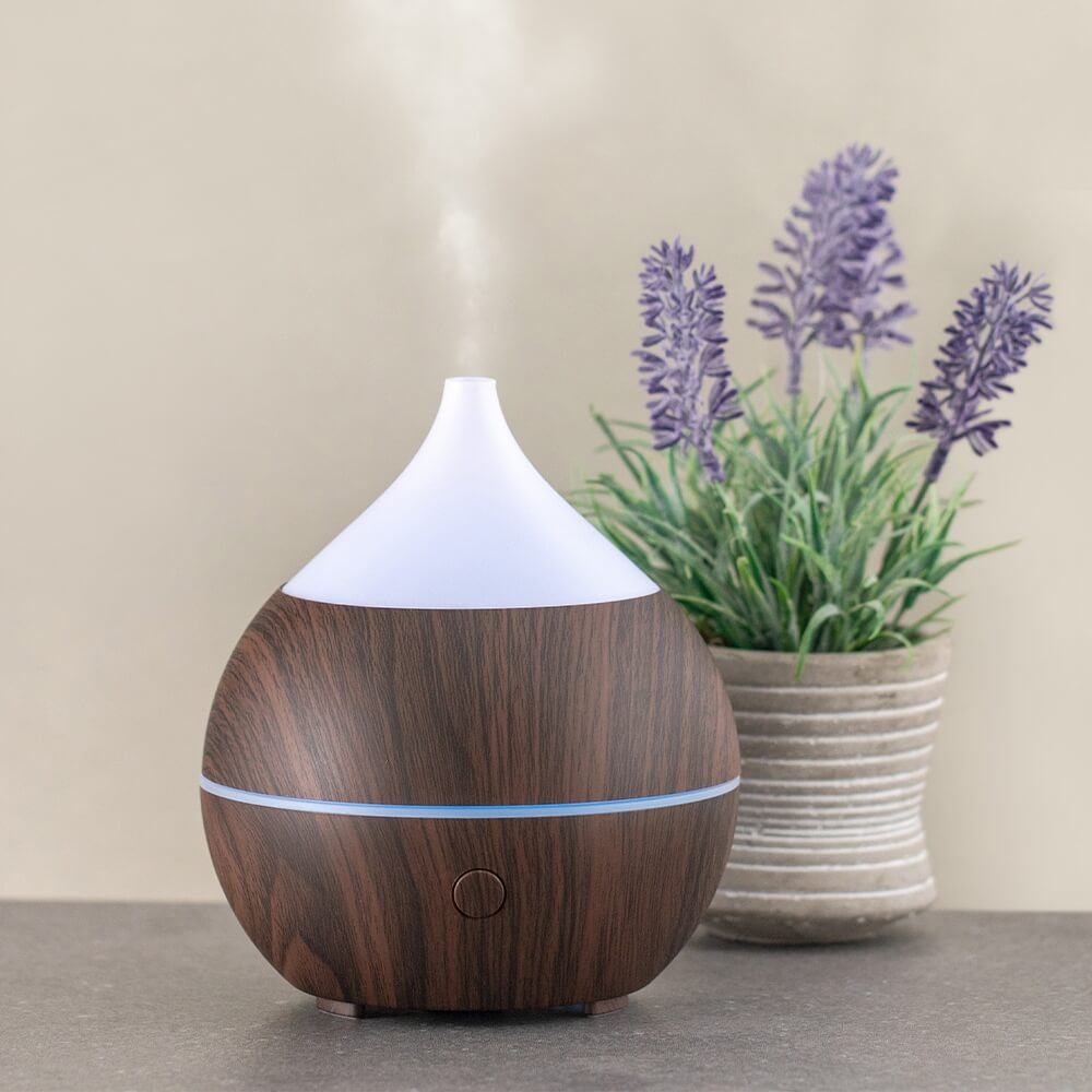 AromaBliss Essential Oil Diffuser on table with lavender